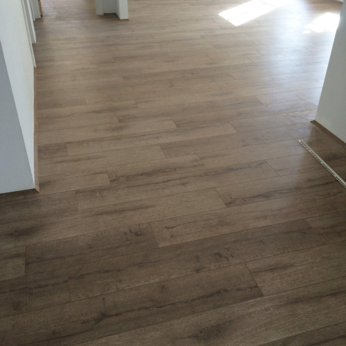 Aged Oak 8253-1 Installation - Tanoa Flooring - 12mm Longboard Laminate Flooring - Advanced Flooring Services