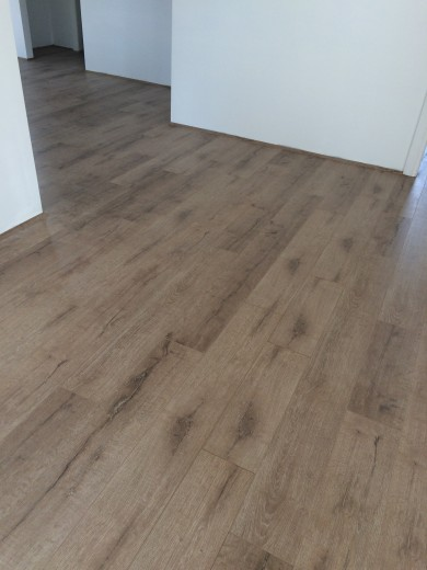 Aged Oak 8253-1 - Tanoa Flooring 12mm Longboard Laminate | Advanced Flooring Services