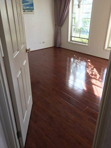 Red Mahogany YA771 - Tanoa Flooring - 12mm Gloss Laminate | Advanced Flooring Services